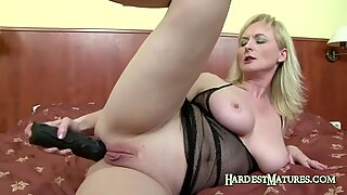 Granny blonde plays with her ass