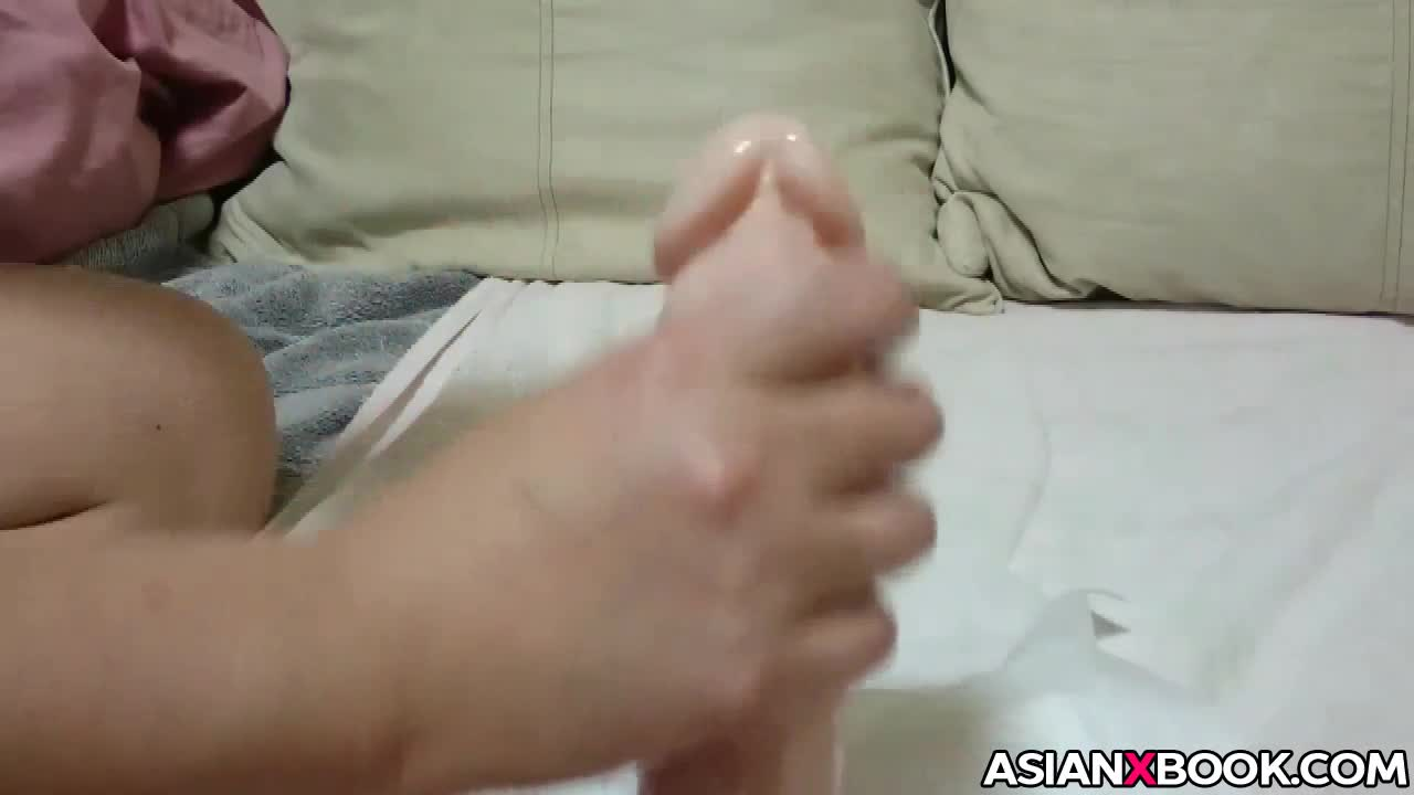 Asian wife wanks big dildo for her husband