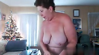 Short haired house wife shows her big old tits and masturbates