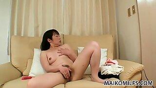 Ugly brunette milf Fumiko Manaka masturbates on the couch